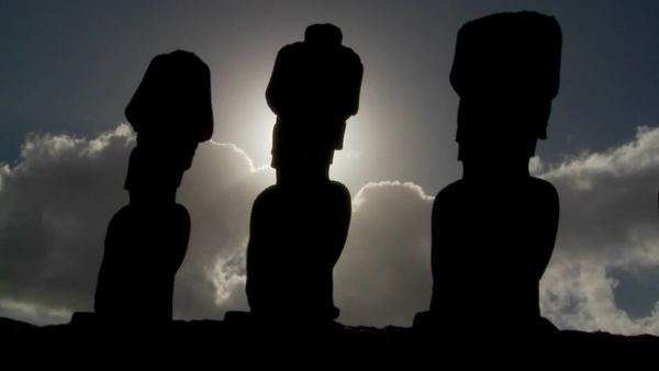 Easter Island statues are silhouetted against the sun. Royalty-free stock video