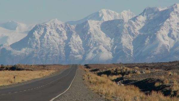 An empty road heads into the remote Andes region of Patagonia. Royalty-free stock video