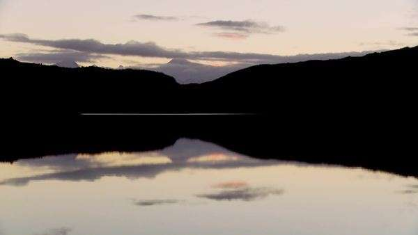 Pan across lakes and peaks in Patagonia, Argentina at dusk. Royalty-free stock video