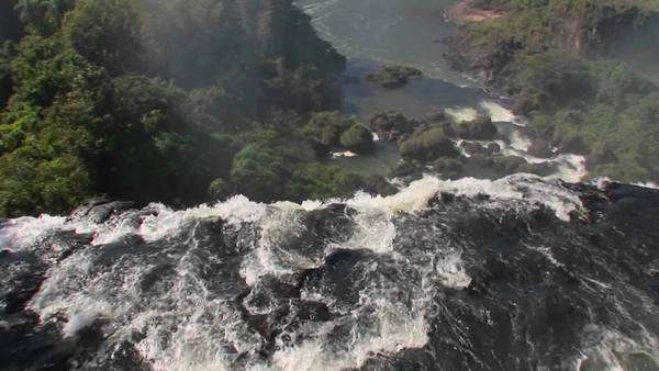 A moving perspective looking over the edge of a waterfall, Iguacu Falls. Royalty-free stock video