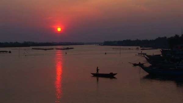 The sun sets behind the Mekong River in Vietnam. Royalty-free stock video