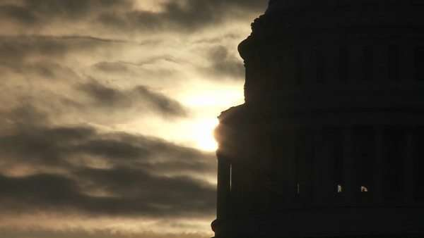A zoom out from the Capitol Building in Washington DC in silhouette. Royalty-free stock video