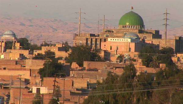 A city in Iran featuring a building with a green dome. Royalty-free stock video