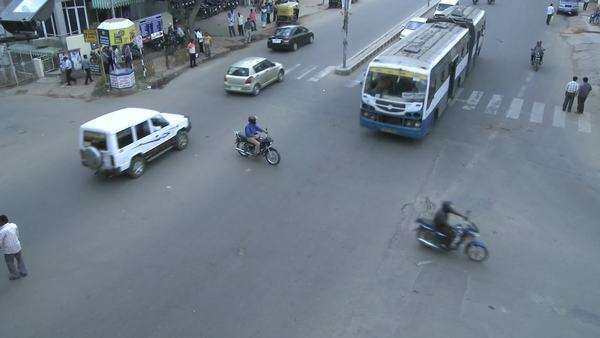 Traffic in a busy intersection in a city in India goes by in time lapse. Royalty-free stock video