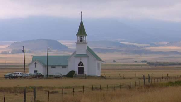 A small church stands on a Montana prairie. Royalty-free stock video