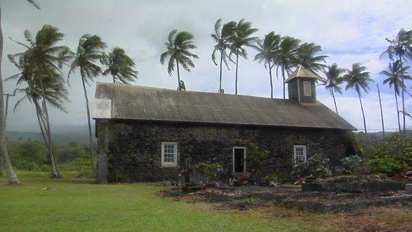 A church stands on a tropical island during a wind storm. Royalty-free stock video
