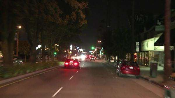 Cars travel through Studio City in California. Royalty-free stock video