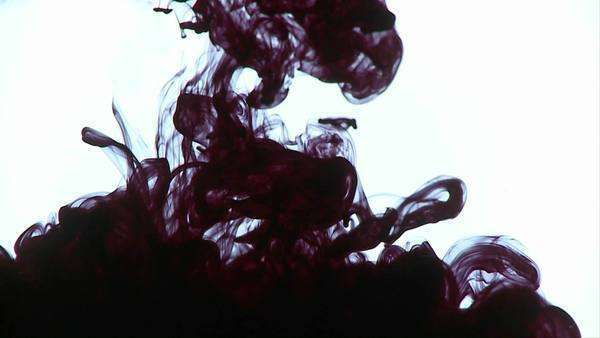 Ink is dropped into water, creating interesting designs. Royalty-free stock video