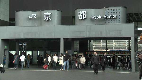Commuters at the entrance to the JR Station Kyoto Japan. Royalty-free stock video