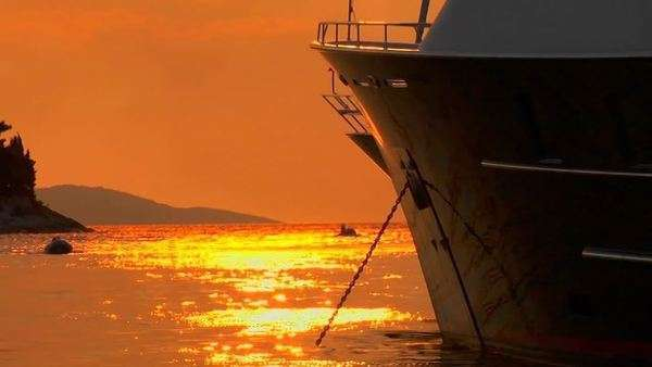 Croatian sunset on the water, ship bow in foreground. Royalty-free stock video
