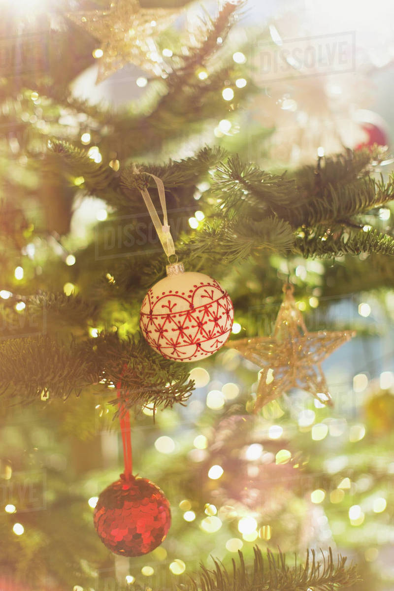Red White And Gold Ornaments Hanging From Christmas Tree Stock Photo