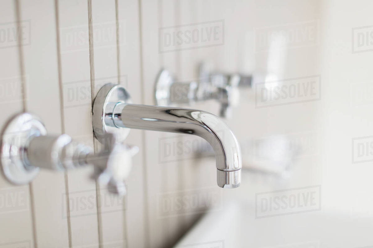Close up modern stainless steel bathtub faucet - Stock Photo - Dissolve