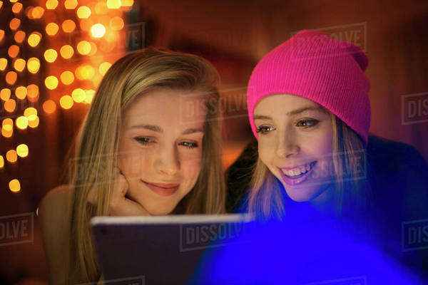 Teenage girls using digital tablet Royalty-free stock photo