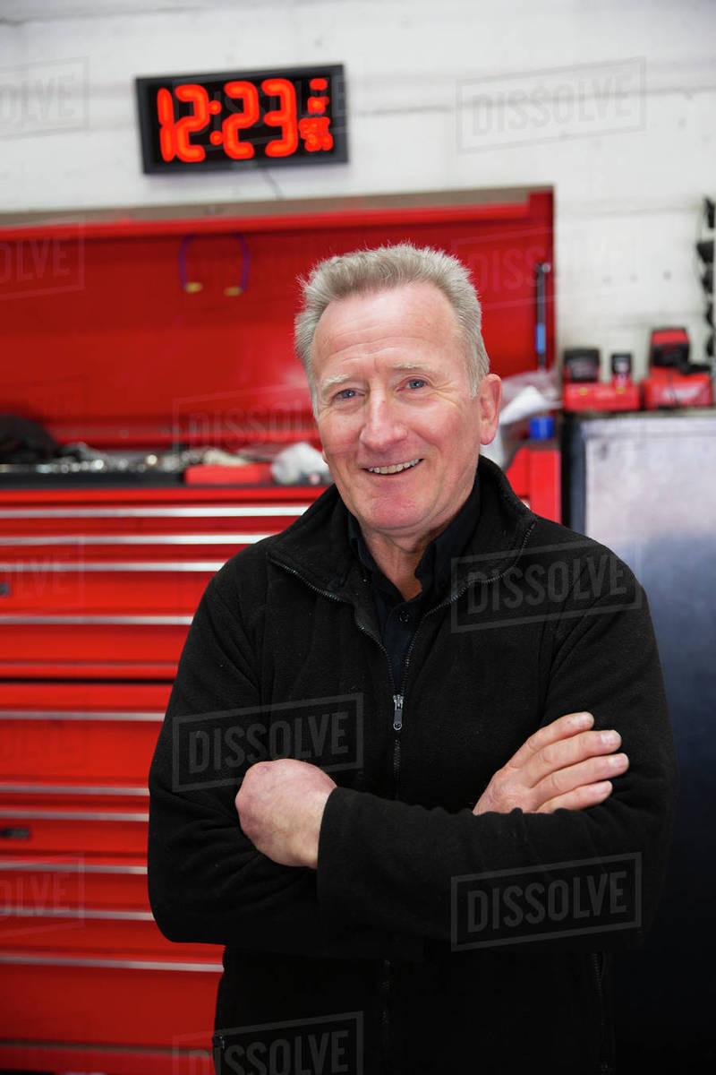 Portrait confident male mechanic in auto repair shop Royalty-free stock photo
