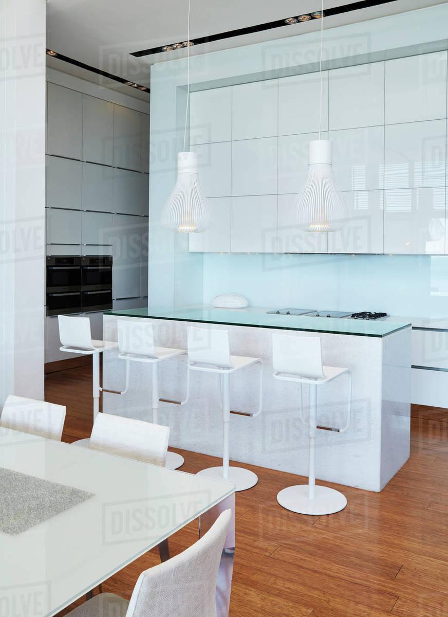 Modern white home showcase kitchen with breakfast bar - Stock Photo ...