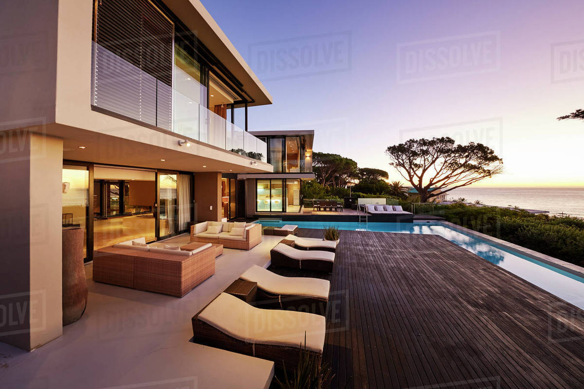 Modern luxury home showcase exterior with swimming pool and ocean view  stock photo