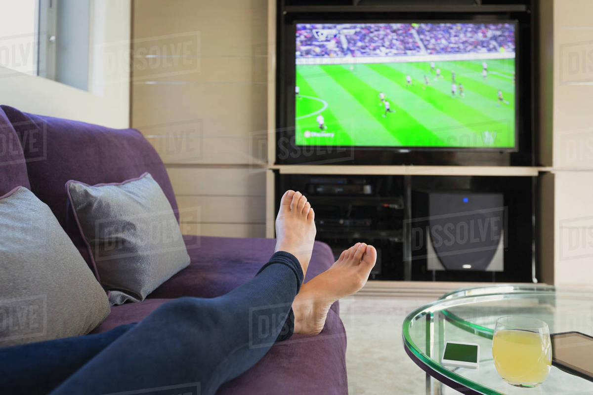 Personal Perspective Woman With Bare Feet Up Watching Soccer Game D1007 5 306