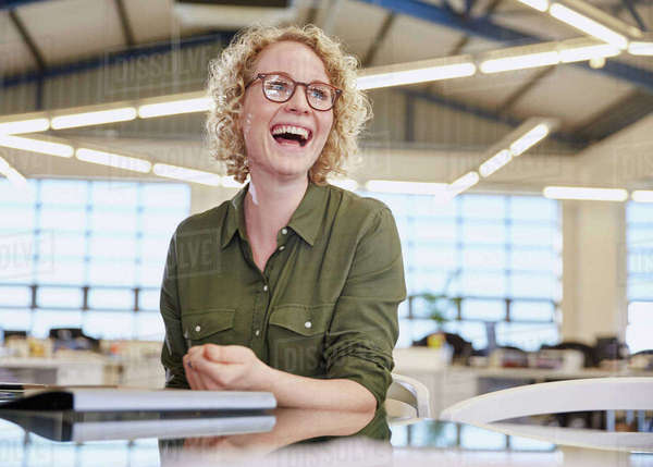 Laughing businesswoman in office Royalty-free stock photo