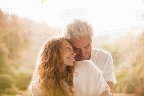 Affectionate couple hugging and smiling Royalty-free stock photo