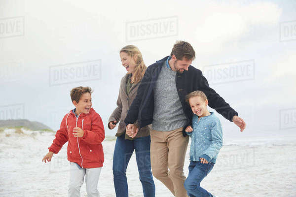 Playful family on winter beach Royalty-free stock photo