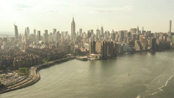 East River | New York City | 4K Aerial clip of the East River in NYC filmed from a helicopter. Royalty-free stock video
