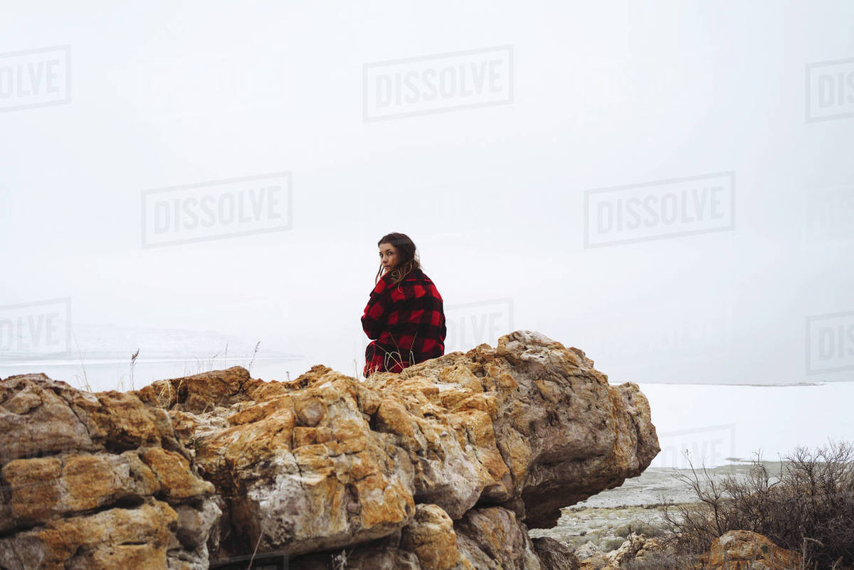 Woman sitting on cliff at Great Salt Lake Royalty-free stock photo
