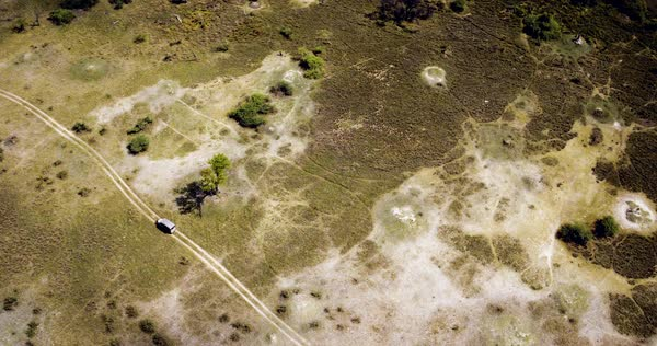 Aerial shot of a truck going in the desert in Botswana Royalty-free stock video