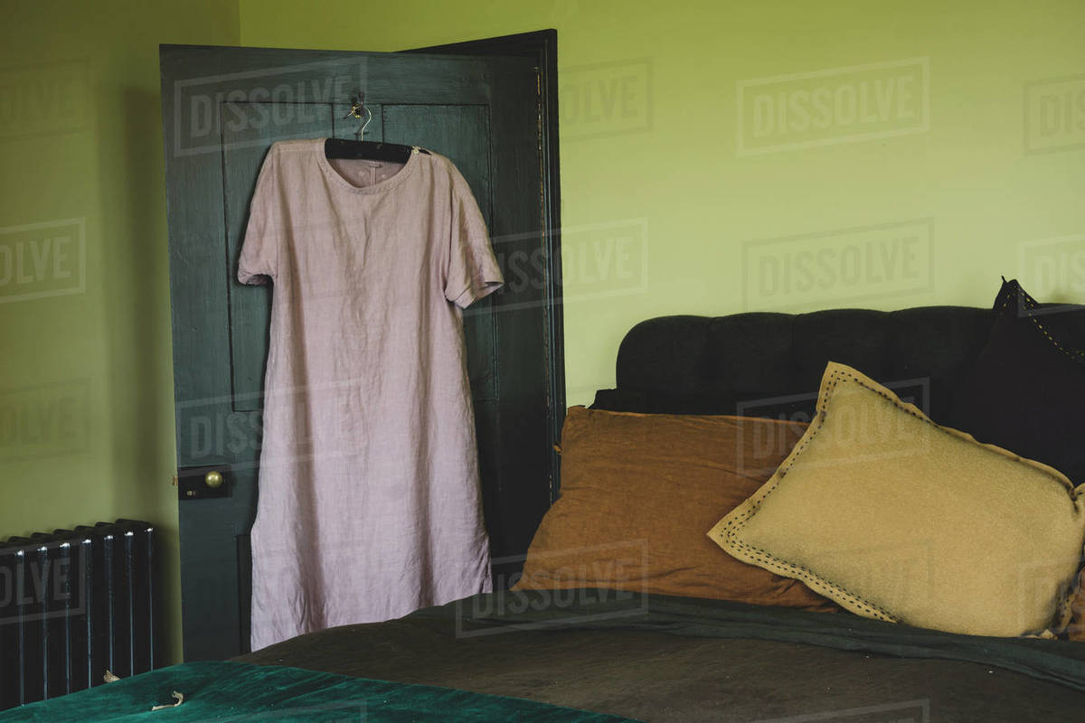 Interior view of bedroom with light green walls, double bed D1024_110_016