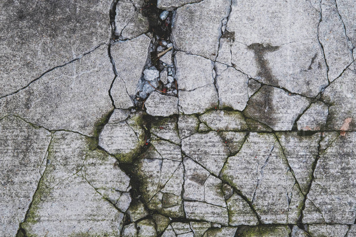 Detail of fractured and cracked concrete sidewalk Royalty-free stock photo