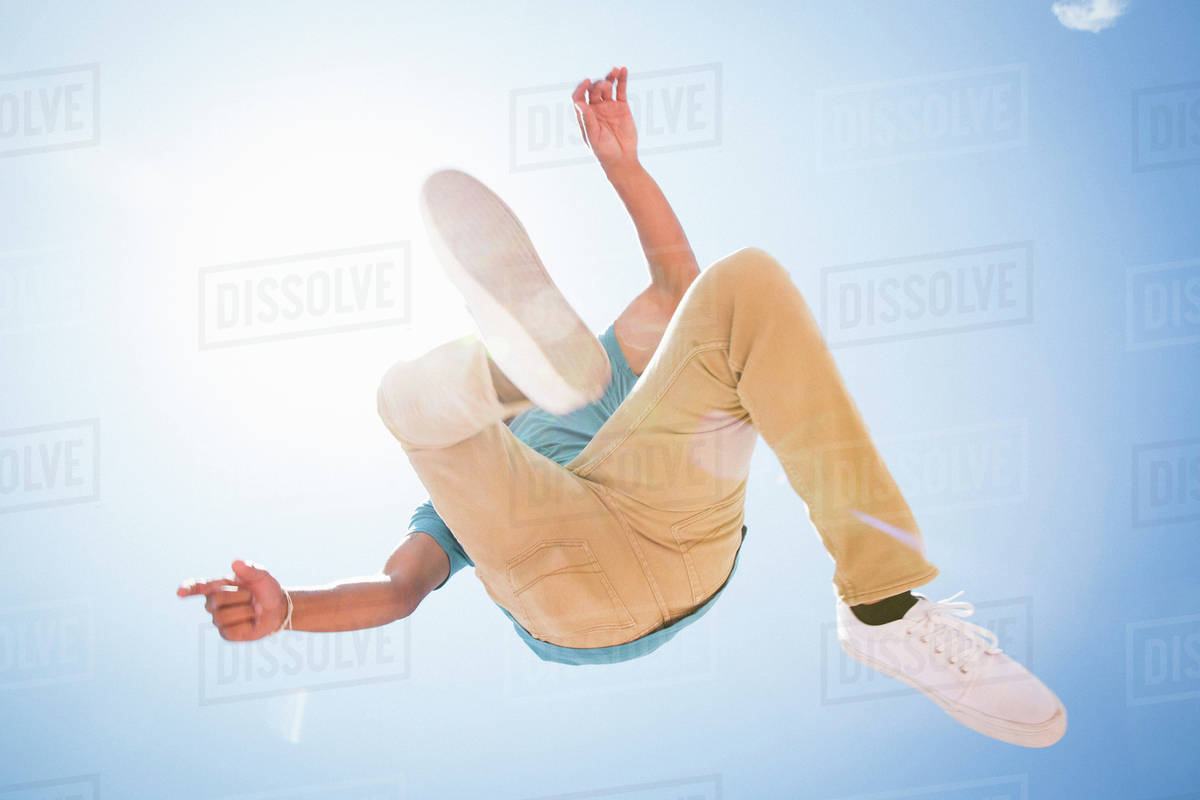 Low angle view of a young man jumping in the air. Royalty-free stock photo