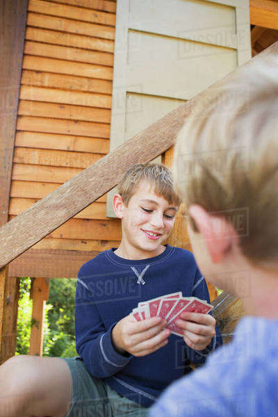 Two brothers playing cards. Royalty-free stock photo