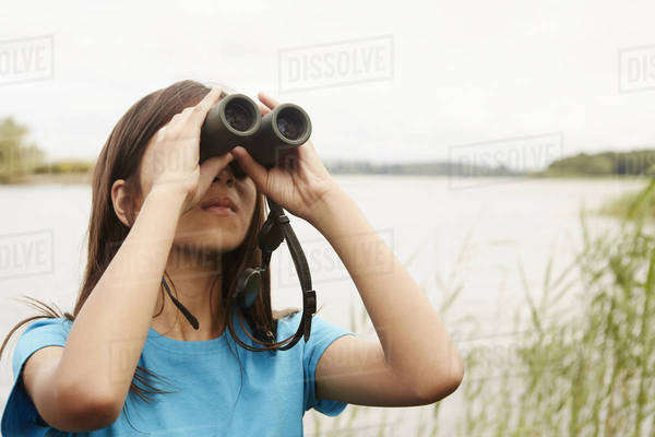 A young girl, a birdwatcher with binoculars.  Royalty-free stock photo