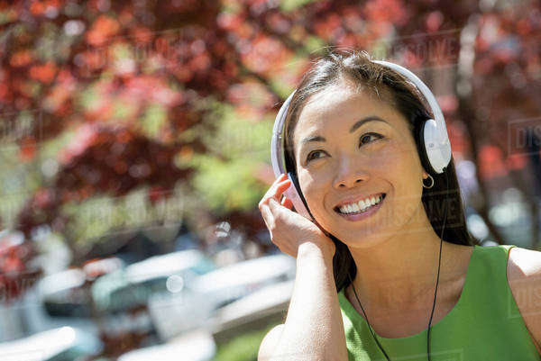 A Woman Listening To Music On Her Headphones Outside. Royalty-free stock photo