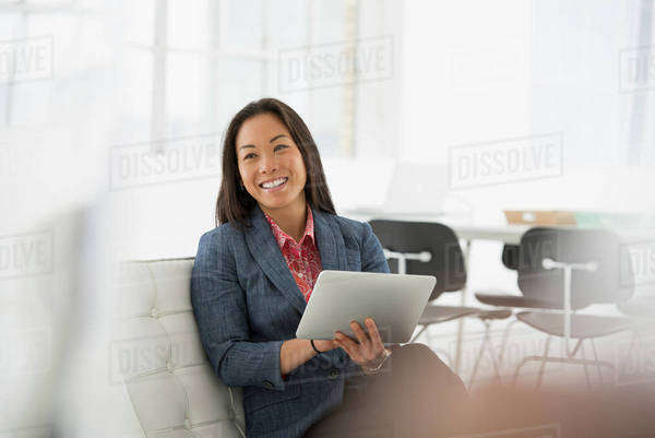 Business. A Woman Sitting Down Using A Digital Tablet. Royalty-free stock photo