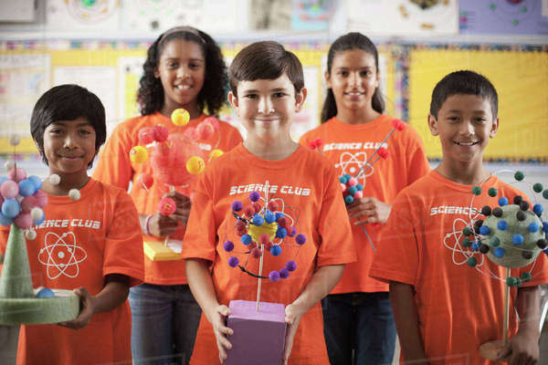 A group of girls and boys wearing the teeshirt of the Science Club, making molecular structure models.  Royalty-free stock photo