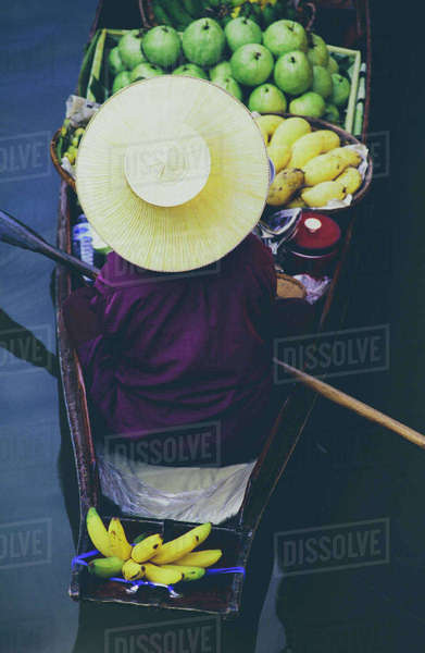 Damnoen Saduak Floating Market, a woman selling goods from boats in floating market  Royalty-free stock photo