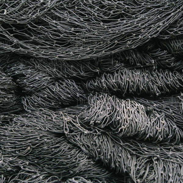 Close up of a pile of tangled up commercial fishing nets. Royalty-free stock photo