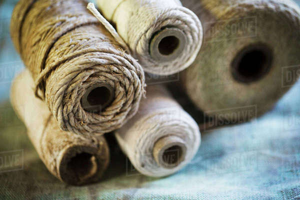 Close up of various bobbins of twine in a sailmaker's workshop. Royalty-free stock photo