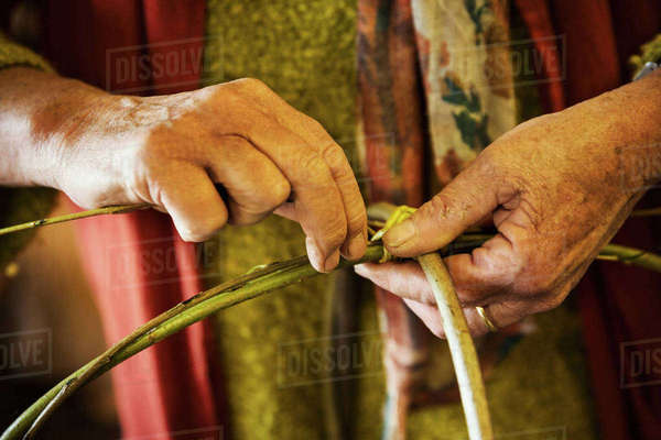 Close up of woman weaving a basket in weaver's workshop. Royalty-free stock photo