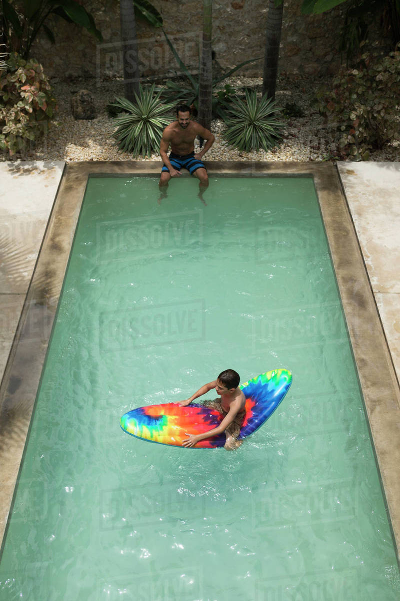 High angle shot of a boy sitting on a pool D1024_88_256