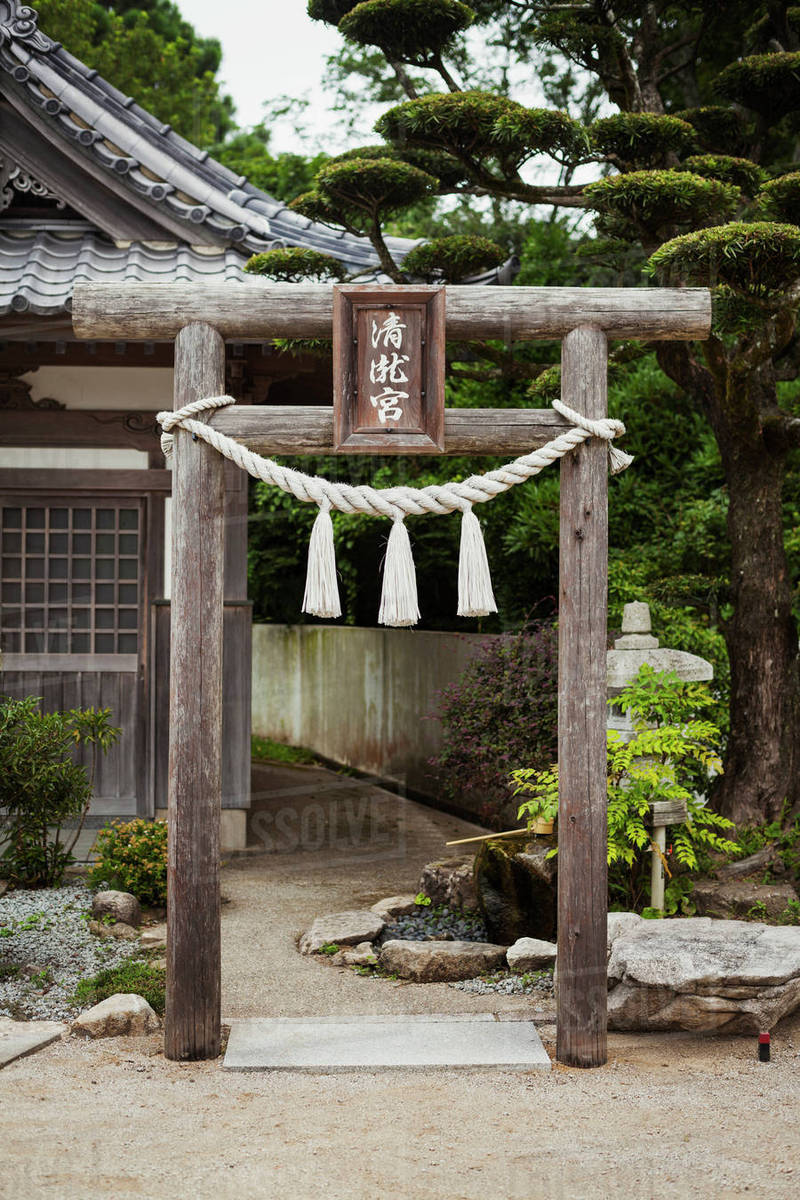 Traditional wooden gate outside a Japanese Buddhist temple  stock photo
