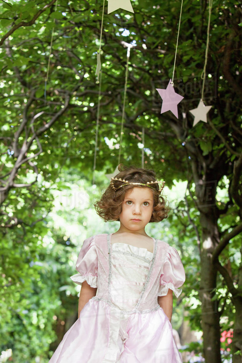Young girl dressed as a fairy at a party in a garden. Royalty-free stock photo