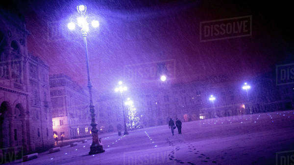 Snowstorm at night in Trieste, Italy Royalty-free stock photo