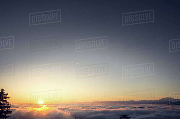 Sun setting above the clouds in Como, Italy Royalty-free stock photo