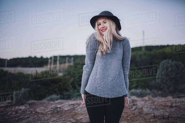 Portrait of a woman standing on a coast Royalty-free stock photo