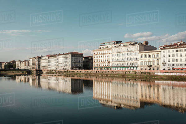 Buildings reflecting in the Arno River in Florence Royalty-free stock photo