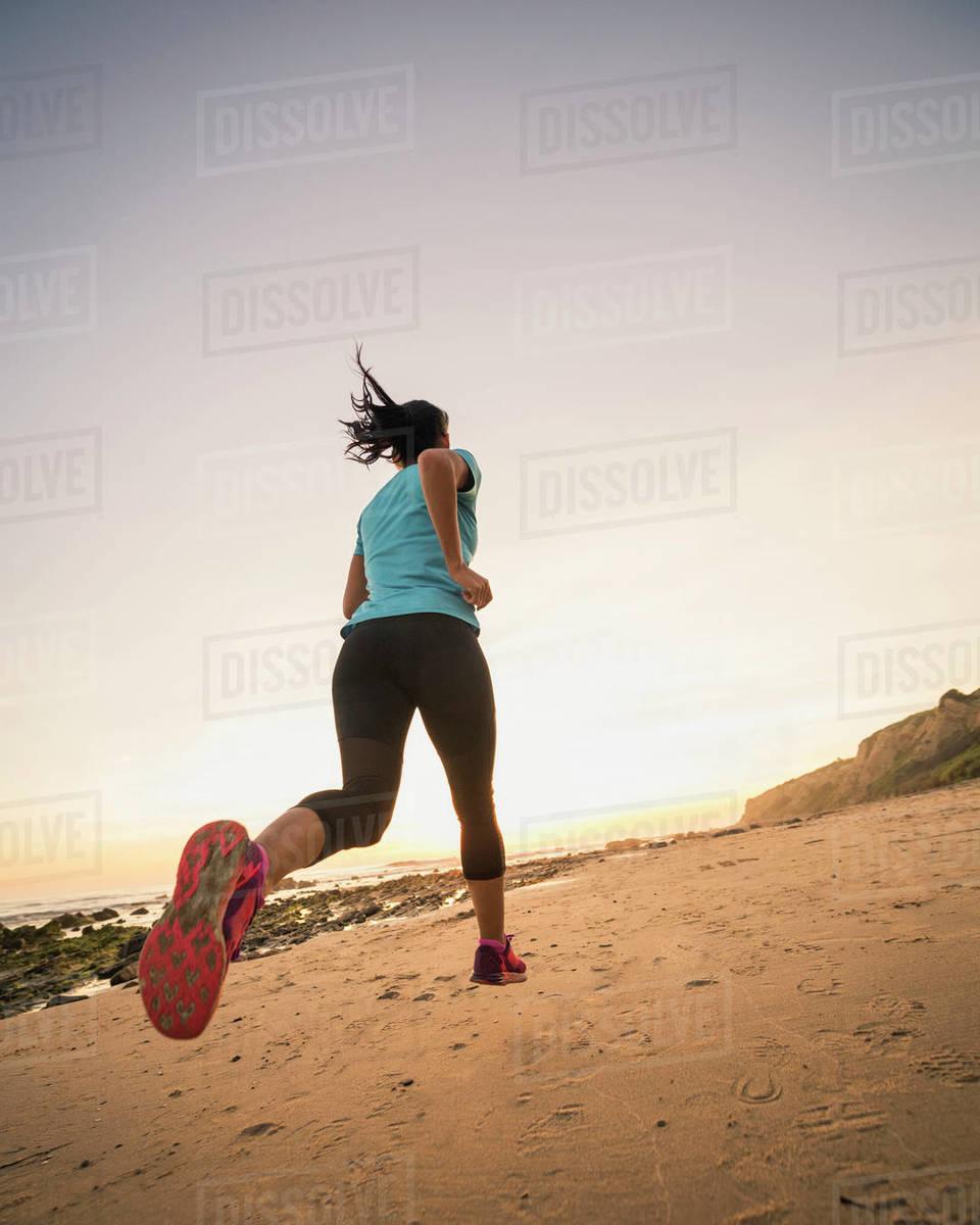 USA, California, Newport Beach, Woman jogging on beach Royalty-free stock photo