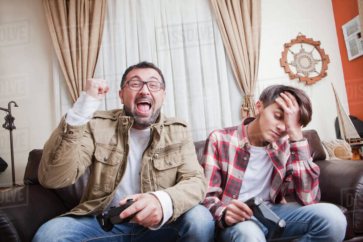 Father and son playing video game Royalty-free stock photo
