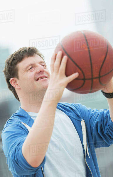 Man with down syndrome playing basketball Royalty-free stock photo