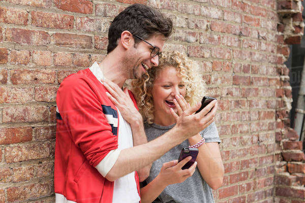Couple sharing messages on cell phones Royalty-free stock photo